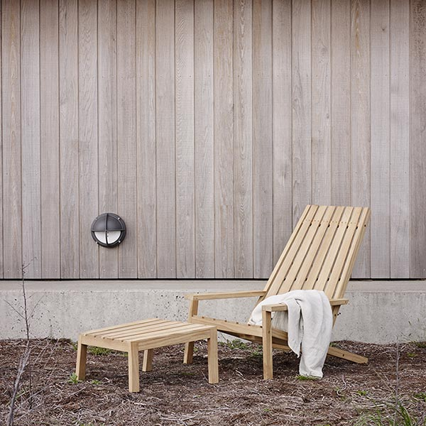 low profile classic adirondack: skagerak's between lines deck chair with stool in teak