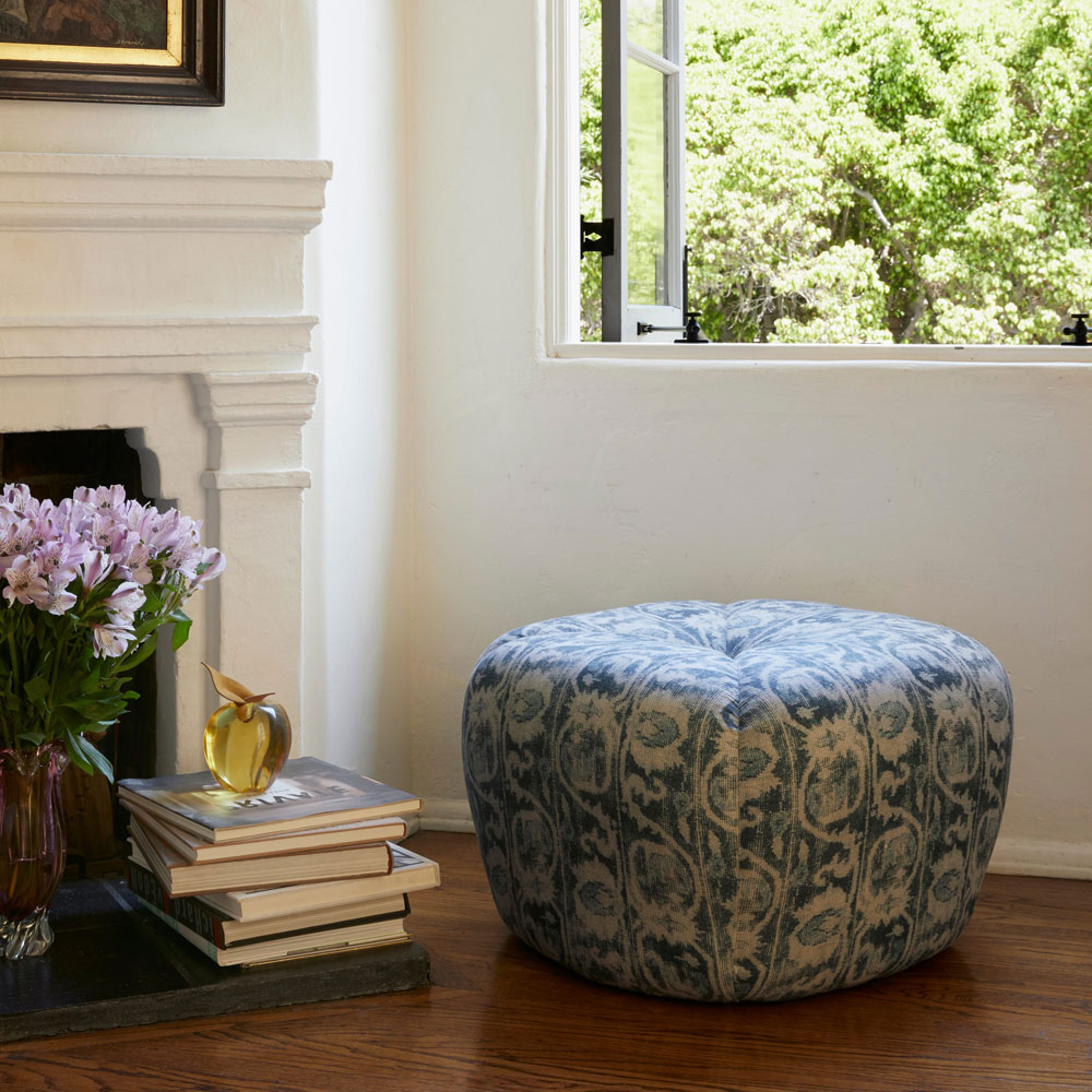 eye-catching ottoman upholstered in aslan peacock fabric