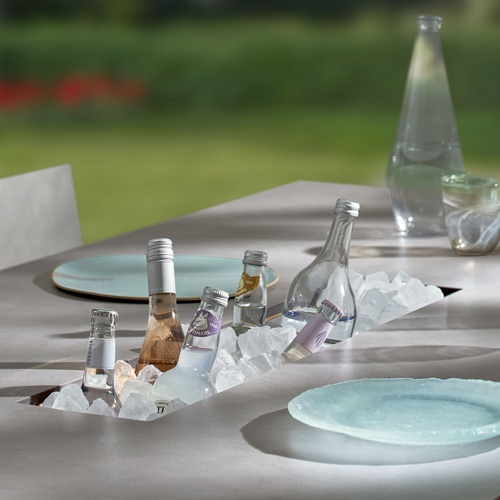 """summer refreshments: the trey 87"""" dining table has a drinks compartment to help you keep cool on a summer day"""