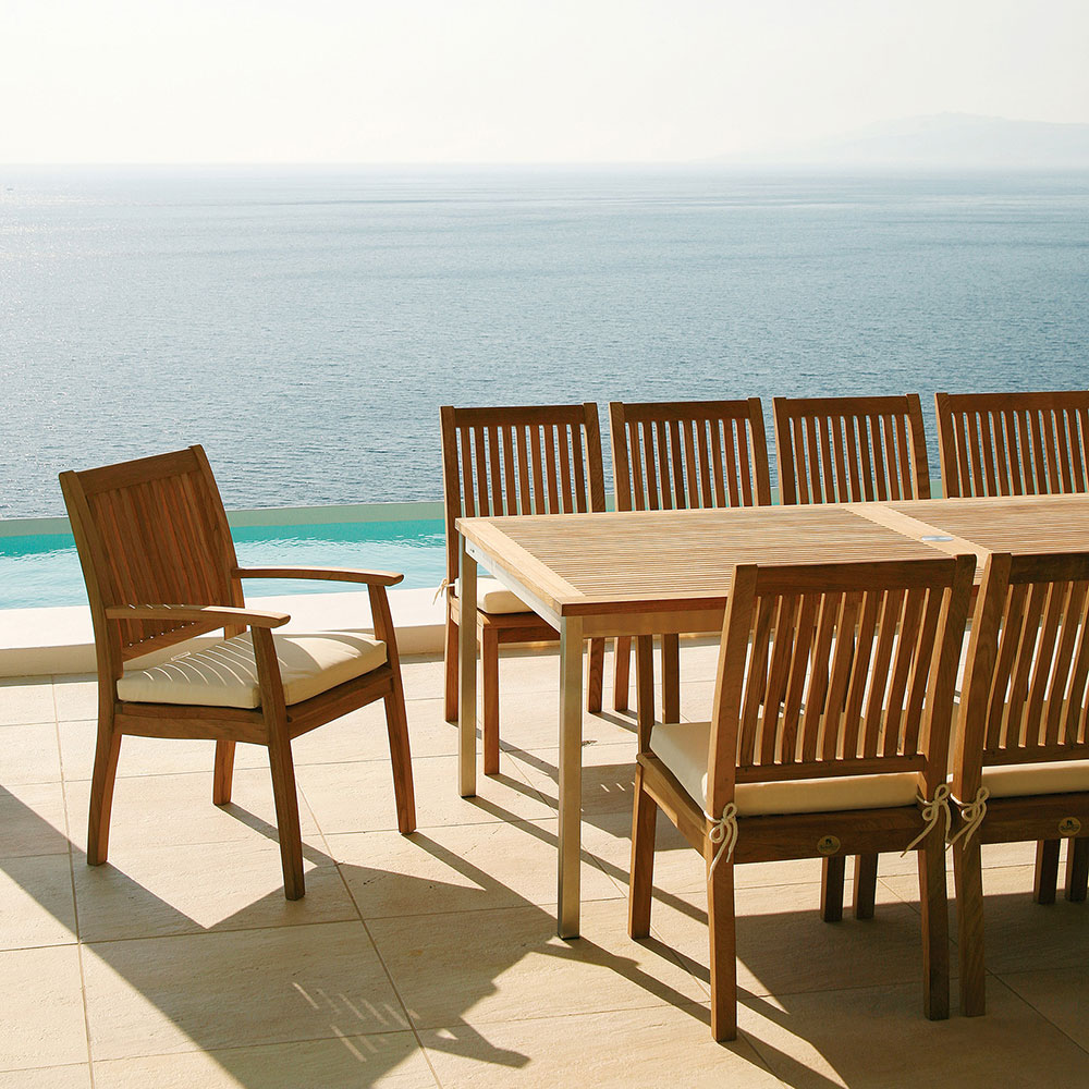 """classic dining: monaco armchairs around an equinox 59-90"""" extending dining table"""