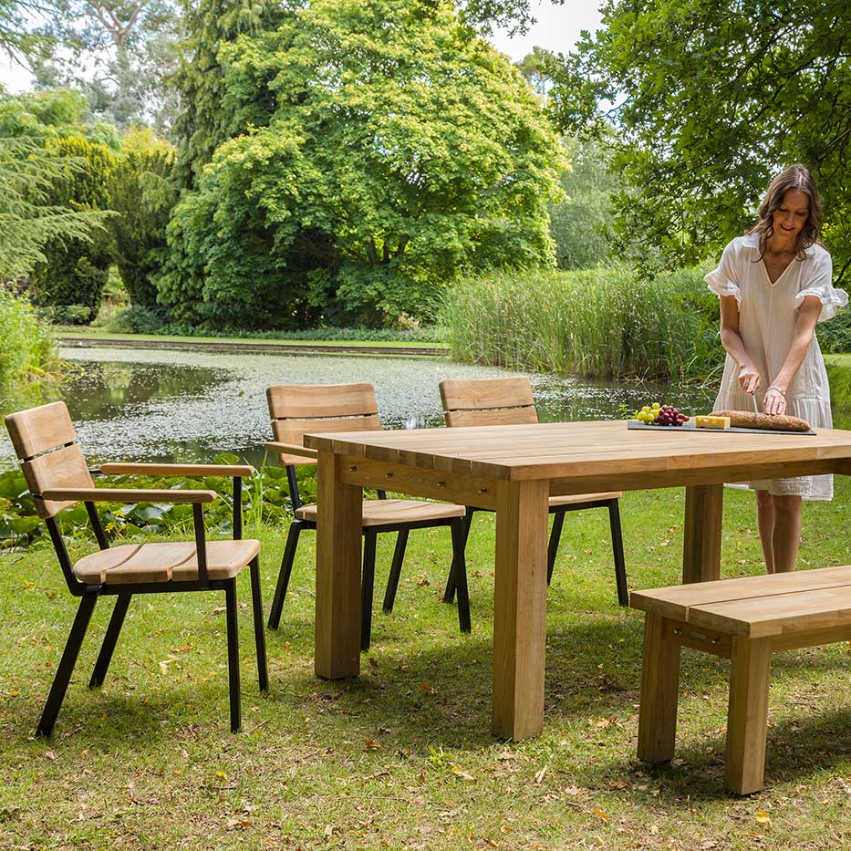 """farmhouse dining: stacking rustic armchairs and a 51"""" backless bench around a 71"""" rustic teak dining table"""