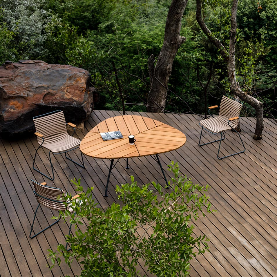 """one with nature: the unique 58"""" leaf dining table surrounded by click dining armchairs"""