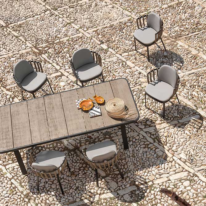 """bird'e-eye view: swing 95"""" dining table surrounded by swing dining armchairs"""