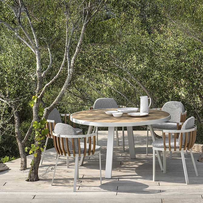 """compact dining: swing 55"""" round dining table with four swing dining armchairs"""