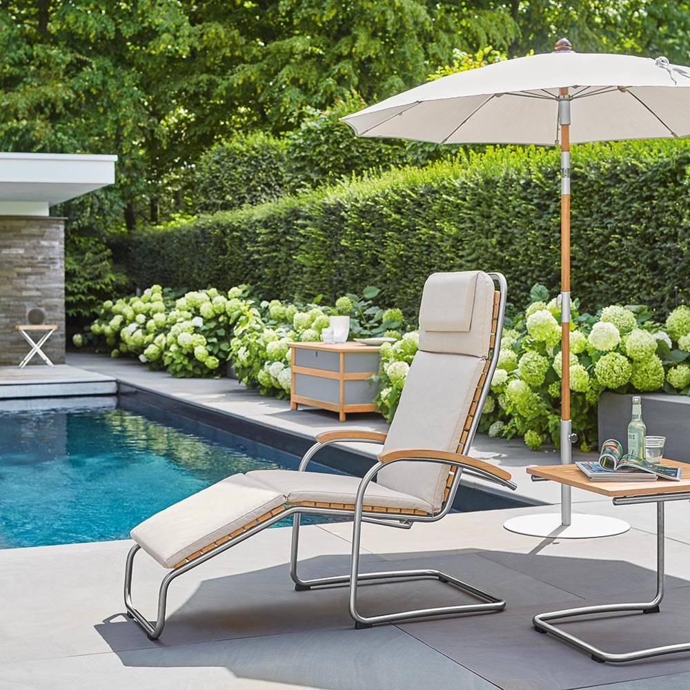 form follows function: the tubular stainless steel frame on the bolero lounge chair invites one to sink into relaxation