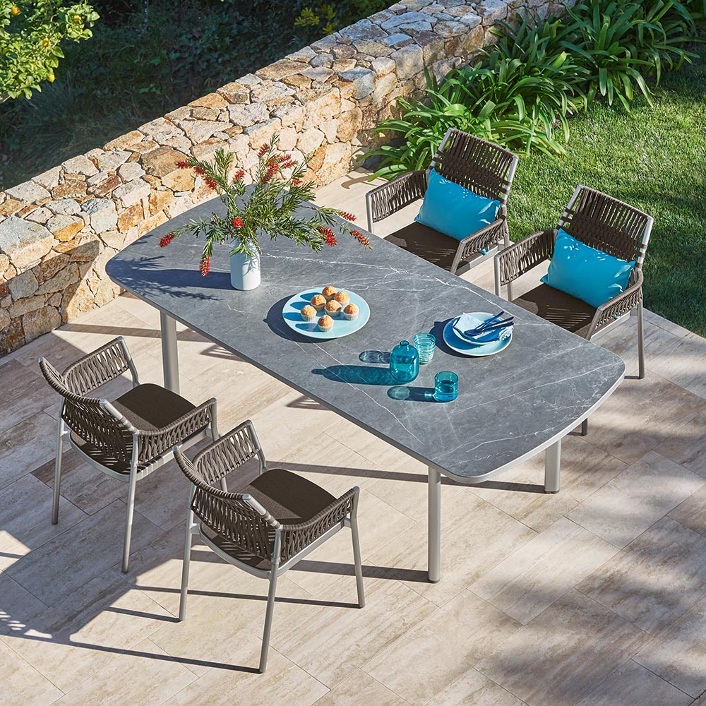 """spacious tables: protruding lateral edges offer comfortable legroom, as on this 87"""" ceramic dining table as on this"""