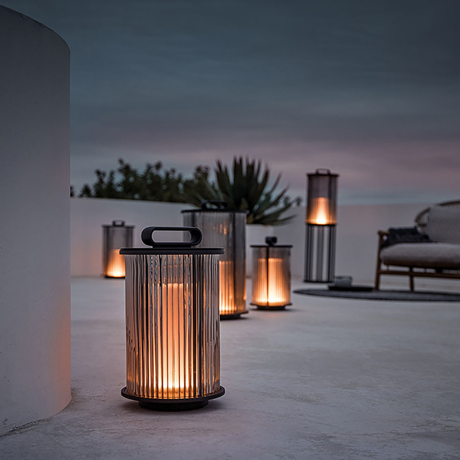 gloster ambient line tall and small lanterns for romantic outdoor ambienceimage provided courtesy of gloster furniture, inc.