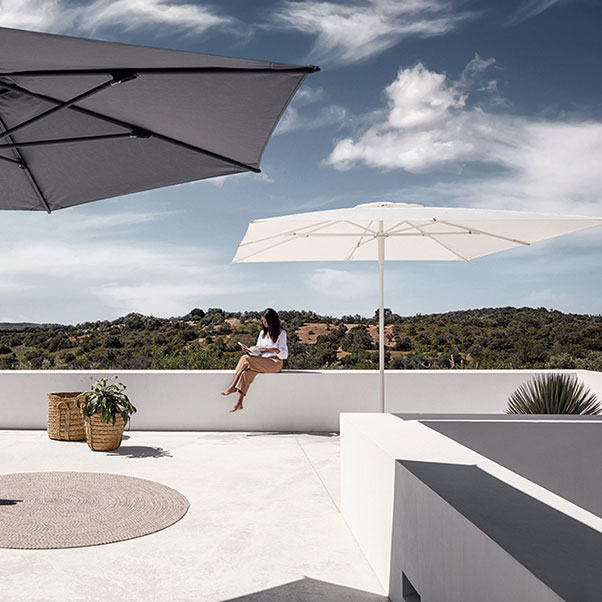 two for larger decks: gloster halo push-up parasols (left: hexagonal | right: square)image provided courtesy of gloster furniture, inc.