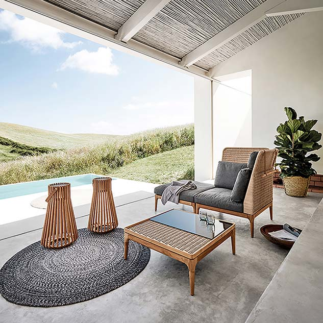 "stretch your legs: lima chaise created by high-back corner/ end unit with optional headrest + ottoman | to the foreground: lima 32"" square coffee table with glass top 