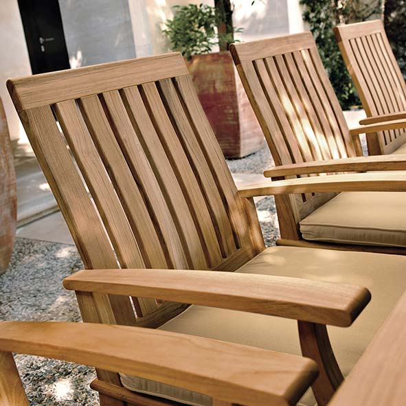 close-up: craftsmanship of ventura's teak dining armchairs with optional notched seat cushion (upcharge applies)image provided courtesy of gloster furniture, inc.
