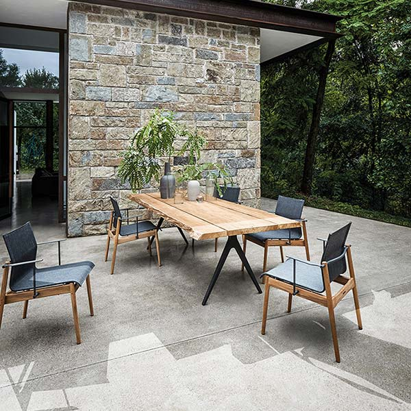 """five sway armchairs in anthracite sling paired with gloster's raw split 110"""" dining table (frame meteor)image provided courtesy of gloster furniture, inc."""
