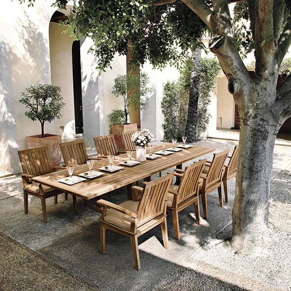 """courtyard dining: eight ventura armchairs with optional notched seat cushions paired with gloster's bristol 86-122"""" extending dining tableimage provided courtesy of gloster furniture, inc."""