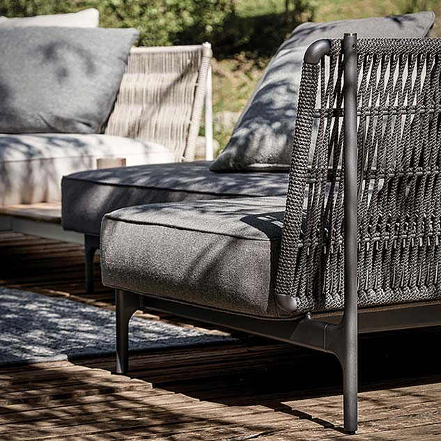 harmonizing robust frame: powder-coated aluminum interwoven with outdoor rope (meteor | shadow)image provided courtesy of gloster furniture, inc.