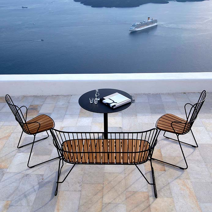 terrace seating: paon two dining chairs and 2-seater bench staged with houe's flor round cafe table