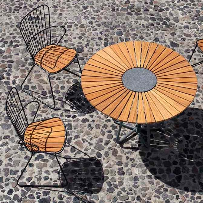 shines with many modern tables: paon seating—here three dining chairs with houe's circle table