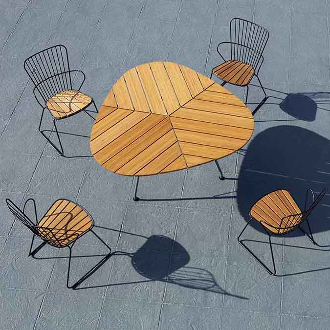 outdoor harmony: four paon dining chairs with houe's leaf table