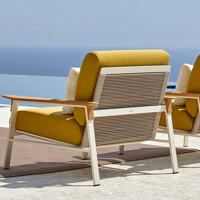 back view: lounge chair in cream aluminum frame and beige rope seat and back