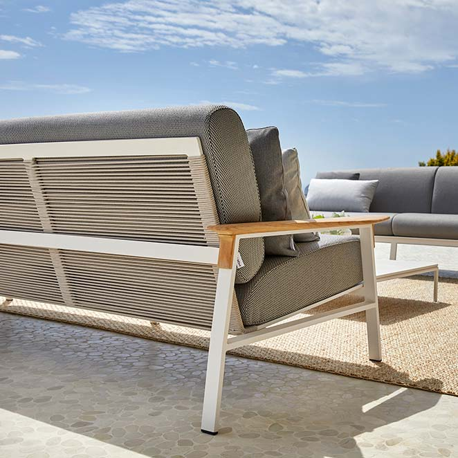 back view: city sofa in cream aluminum frame and beige rope seat and back