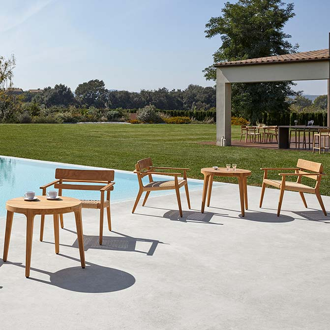 """lounging at the pool: paralel club armchairs staged with 31"""" round coffee tables (tables available through the paralel deep-seating collection)"""
