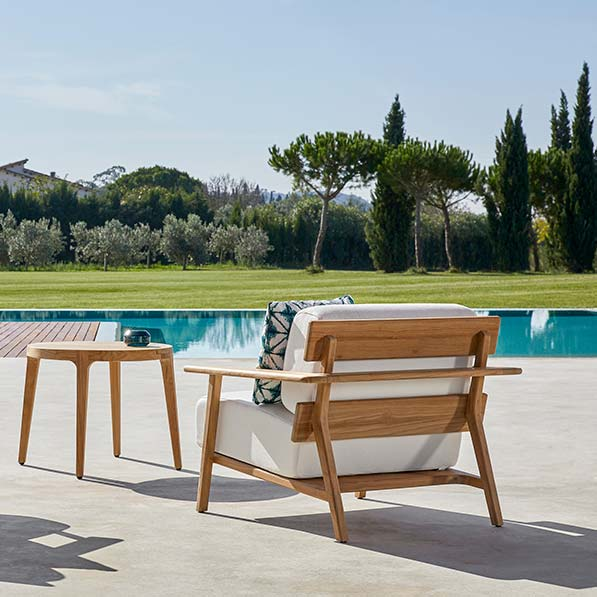 """back view: two paralel lounge chairs with teak frame and 31"""" round side table"""