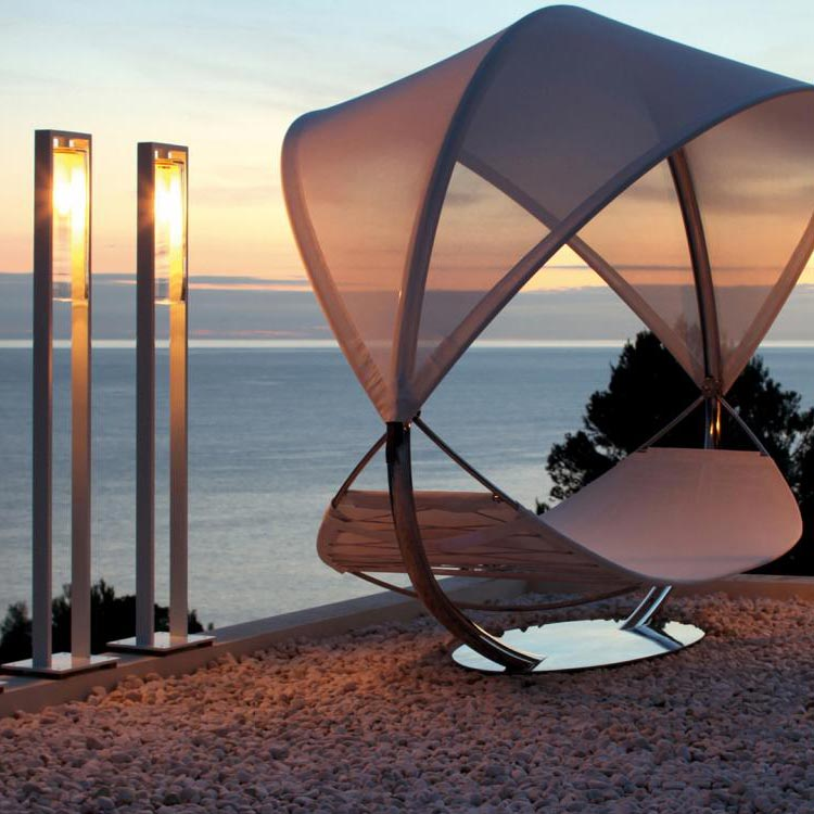 romantic ambiance: three dome floor (left) and one dome move (right) staged with royal botania's wave luxury canopy hammock (dome lighting only available with black frame in US)