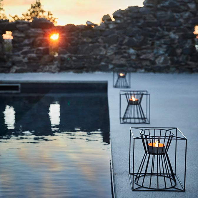 framing your pool: boo candle holders lined up