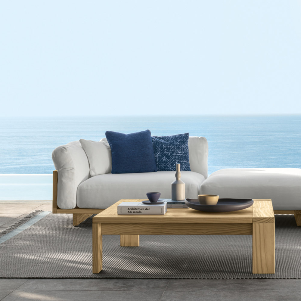 cozy deep seating: the argo sofa + pouf and sofa xl form a sectional with deep embracing cushions