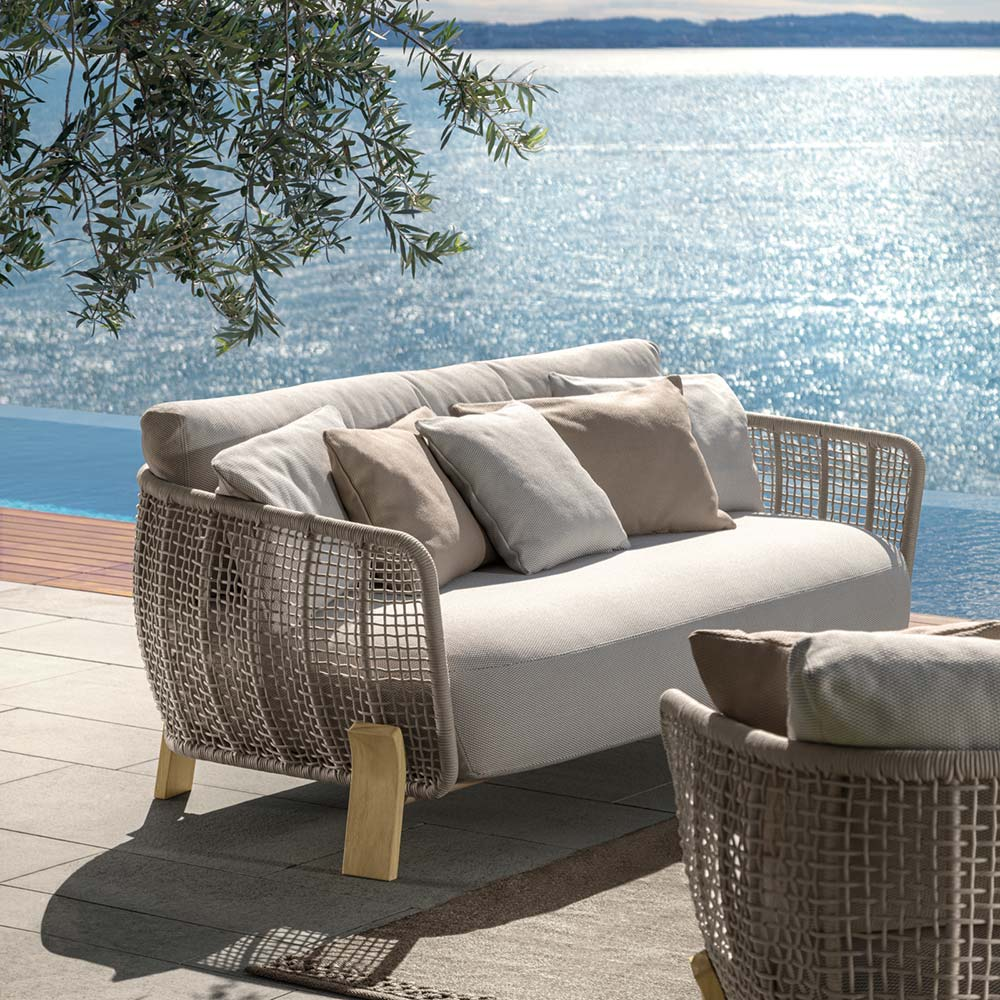 designer details: thoughtful touches like curved wooden feet and nautical woven ropes make the argo sofa loveseat a stand-out piece