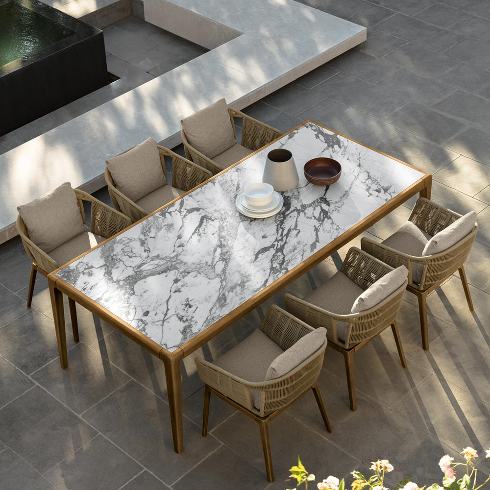 classic italian look: the cruise dining table has a stunning porcelain stoneware top in the style of capraia marble