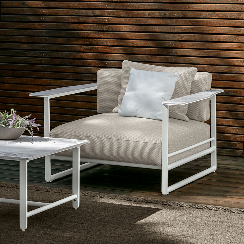 comfort meets sophistication: the riviera living chair sports a wide and deep seat for stylish relaxation