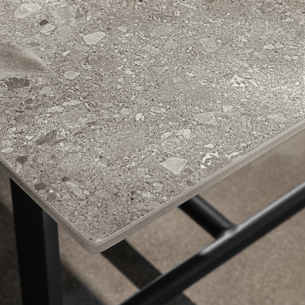 ceppo di gré: riviera dining table porcelain stoneware table top in the style of ceppo di gré, a stone quarried in lombardy with large pebbles
