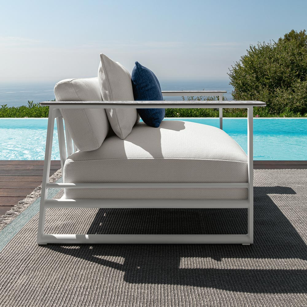 light and timeless lines: side profile of the riviera 2-seater sofa