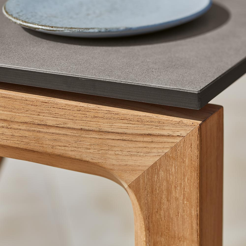 beautiful materials: the trey collection combines warm hued teak and cool grey synthetic resin