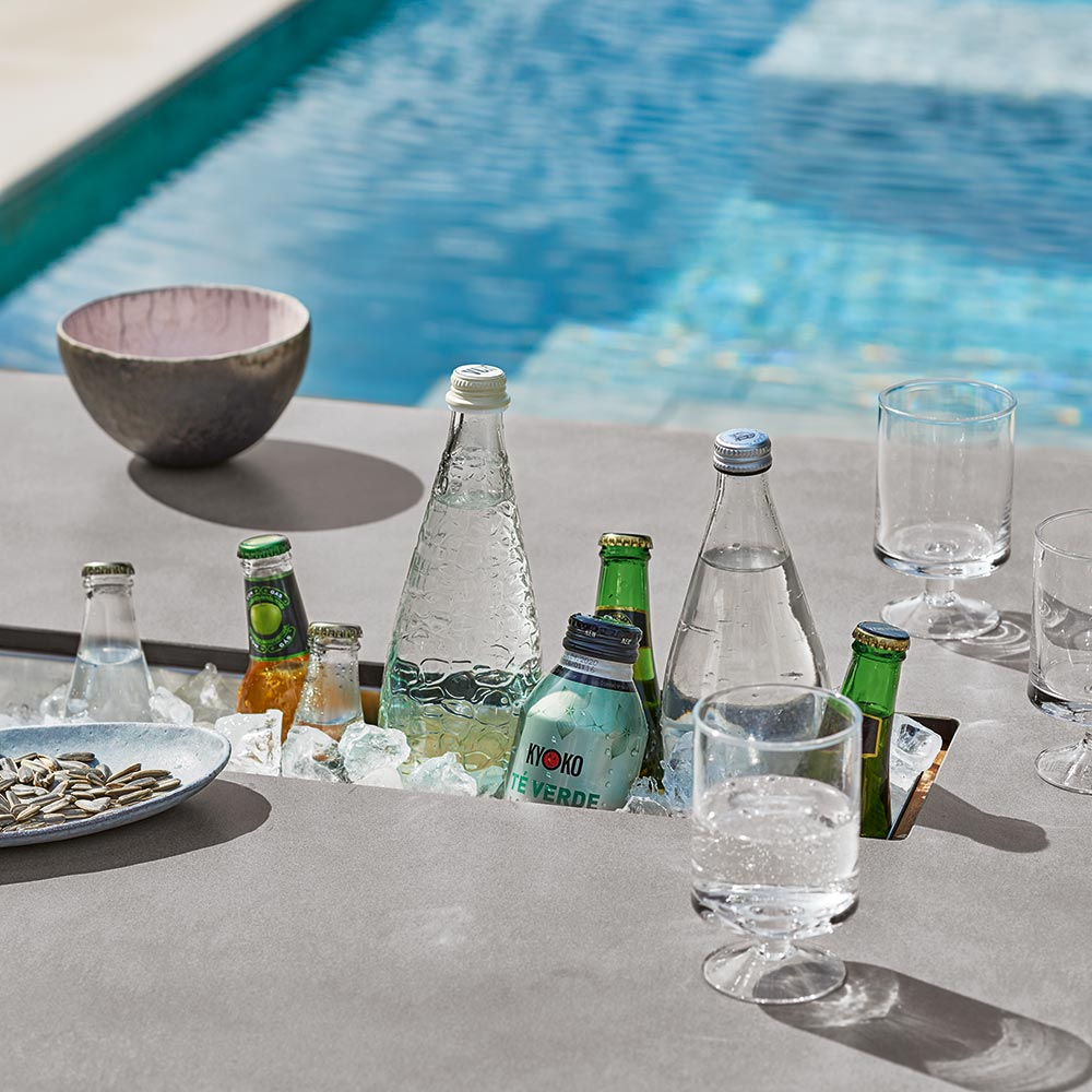 """ice compartment: the trey 87"""" dining table has a recessed stainless steel compartment that holds ice and drinks"""