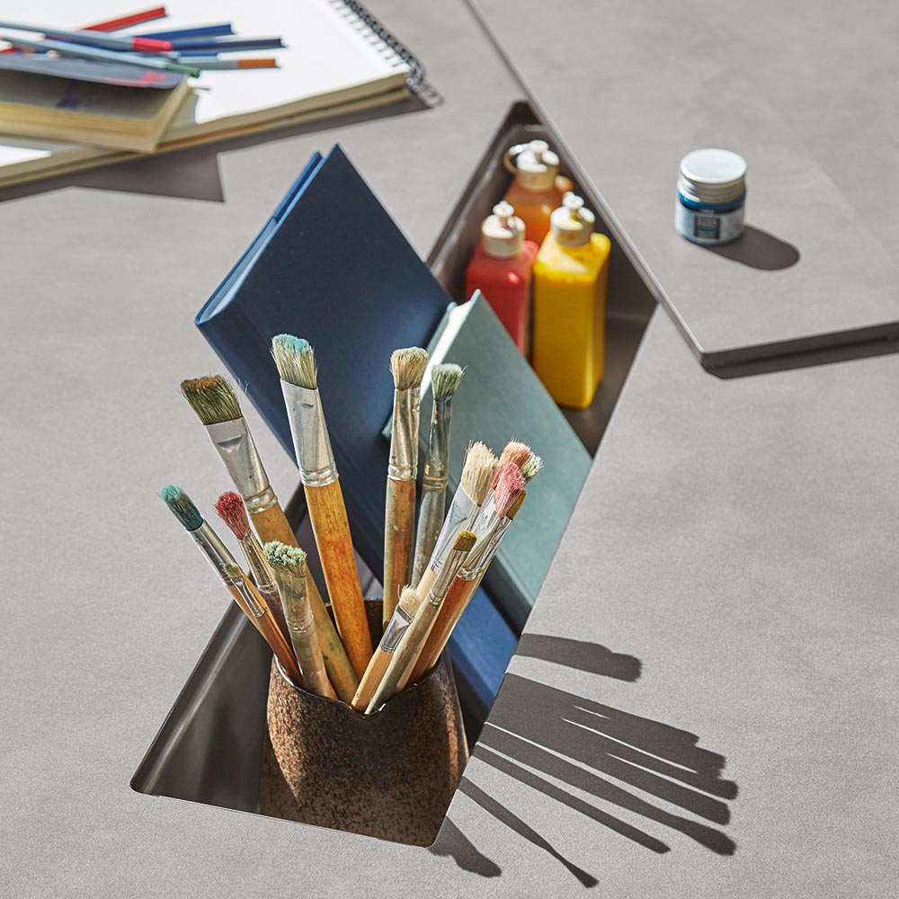 handy storage: the stainless steel compartment provides space for plants, drinks, and even art supplies