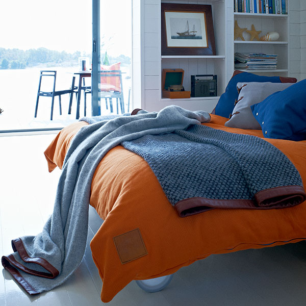 tired? pillow nyan (dark blue/ leather corners), hemse (charcoal chine/ orange insert) and ava (dark blue/ copper buttons) with skargaarden's throw collection are the perfect combo