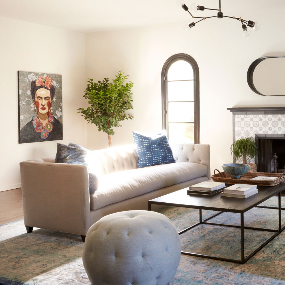 opposite: 2 kenso sofas facing each other in cisco's prairie oatmeal (throw pillows optional); pouf round ottoman in foreground