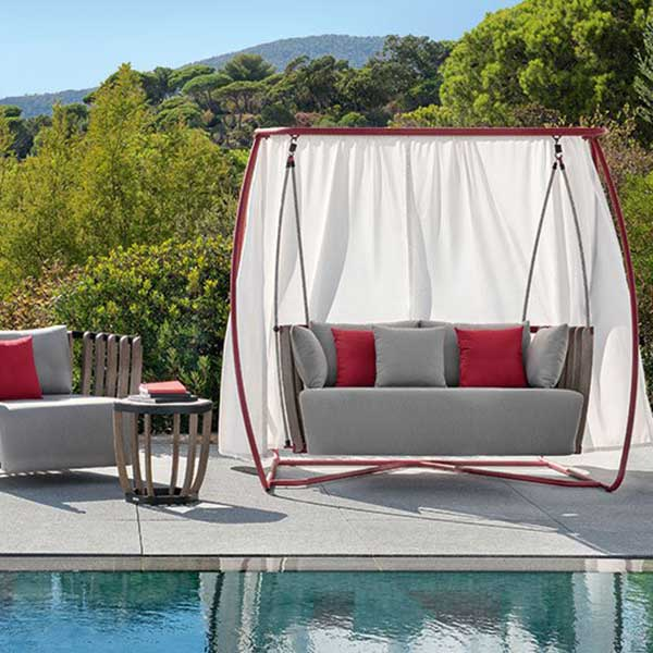 cocoon-like nest: ethimo's porch swing and swing lounge armchair