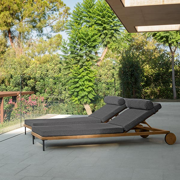 lounging comfortably: two cleo sunbeds with wheels in teak and dark grey cushions (wheels and neck roll included)