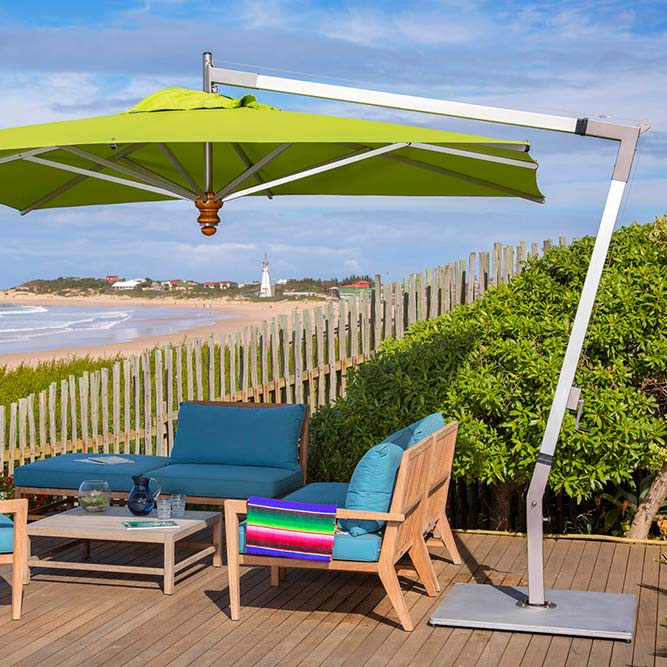 first row shaded seating: pendulum 11.5' square cantilever with sunbrella macao canopy