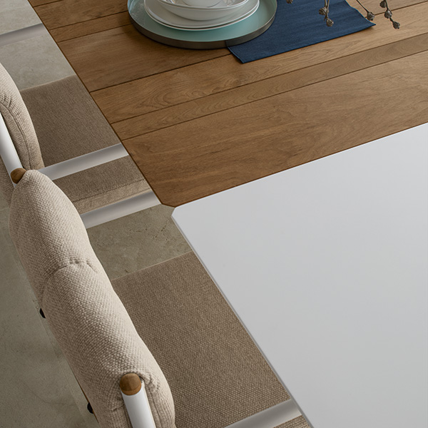 close-up: clean, modern, innovative extension of the domino dining table in white aluminum