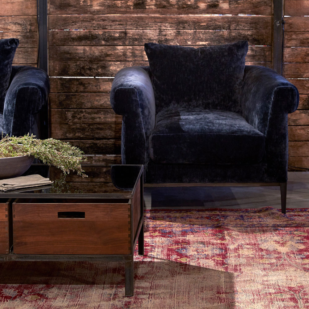 sumptous rolled arms of the henry chair shown in velluto midnight