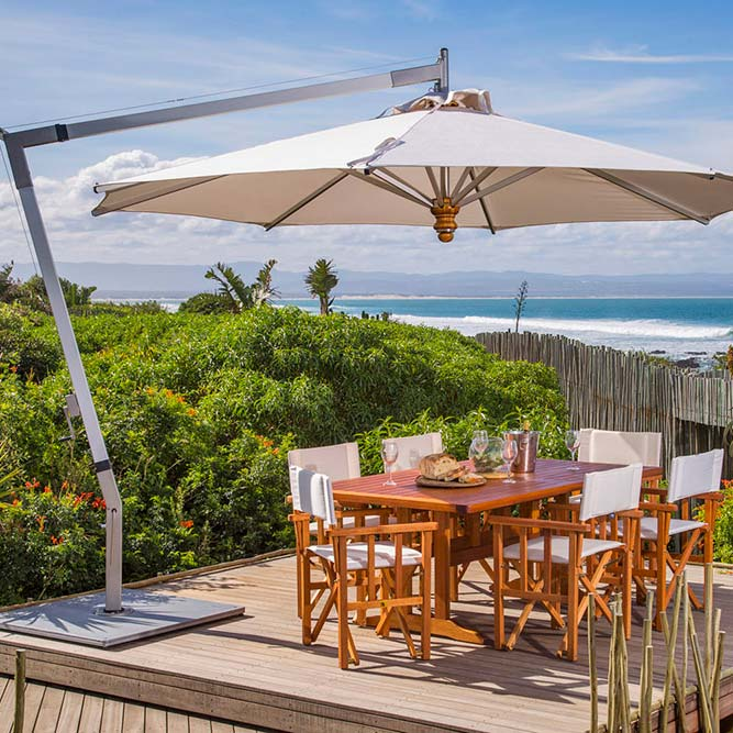satisfying dining experience: pendulum 13.1' round cantilever with sunbrella canvas canopy