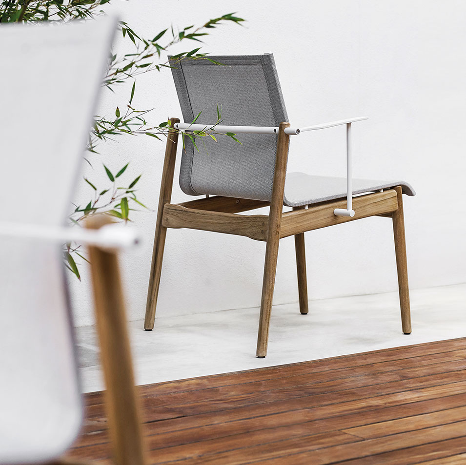 beautiful profile of the sway chair image provided courtesy of gloster furniture, inc.