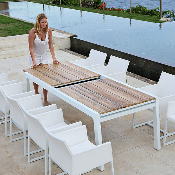 """extension step one: pull out each side of the baia 90.5-142"""" extension dining table (shown here with mono dining chairs)image provided courtesy of mamagreen, llc."""