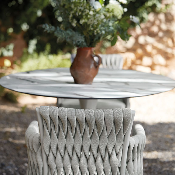 beautiful profile view of the korol HPL table surface and the back of basket chair by sifas