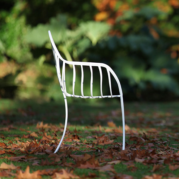 side view: folia chair in white-coated stainless steel