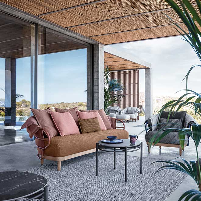 """never get tired of your seating space: dune 2-seater sofa and lounge chair paired with 26"""" dune side tableimage provided courtesy of gloster furniture, inc."""
