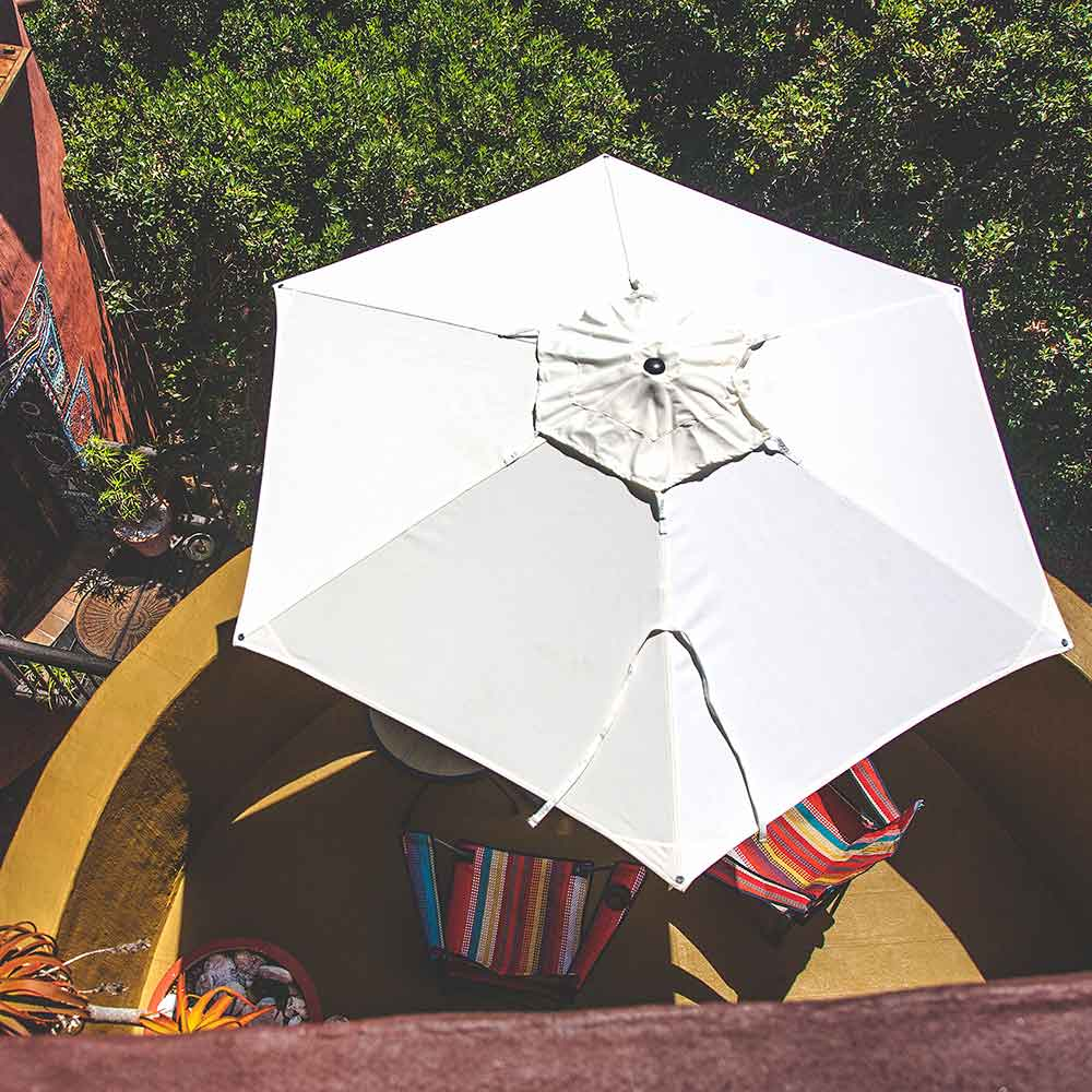 hiding from the sun anywhere: easily portable swift round center pole umbrella with sunbrella natural canopy