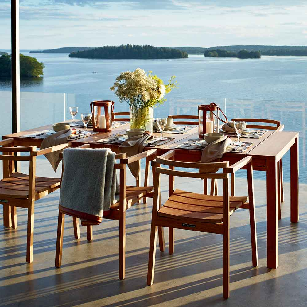 """enjoy the view: six oxno armchairs, one skargaarden morup throw paired with oxno 86"""" dining table (all teak)"""